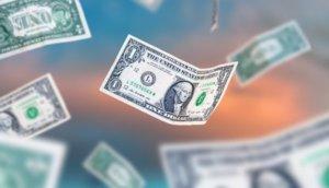 Dollar bills falling to the ground