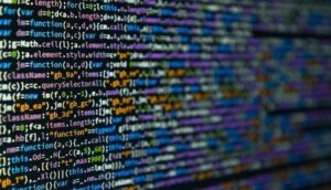 Program code on dark background (selective focus)