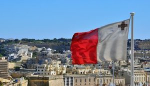 Maltese flag and cityscape