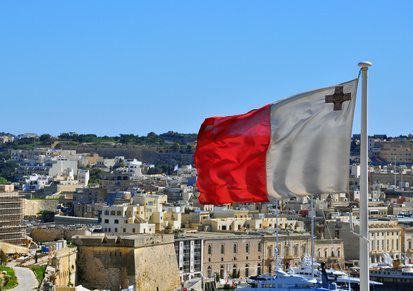 Maltese flag and cityscape