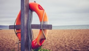 Life buoy on post at the beach