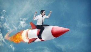 asian business man flying ride rocket