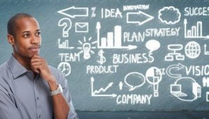 Black businessman looking business scheme.