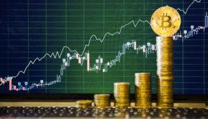 Bitcoins sind vor einer Chartanalyse gestapelt