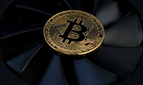 bitcoin coin that is on a fan