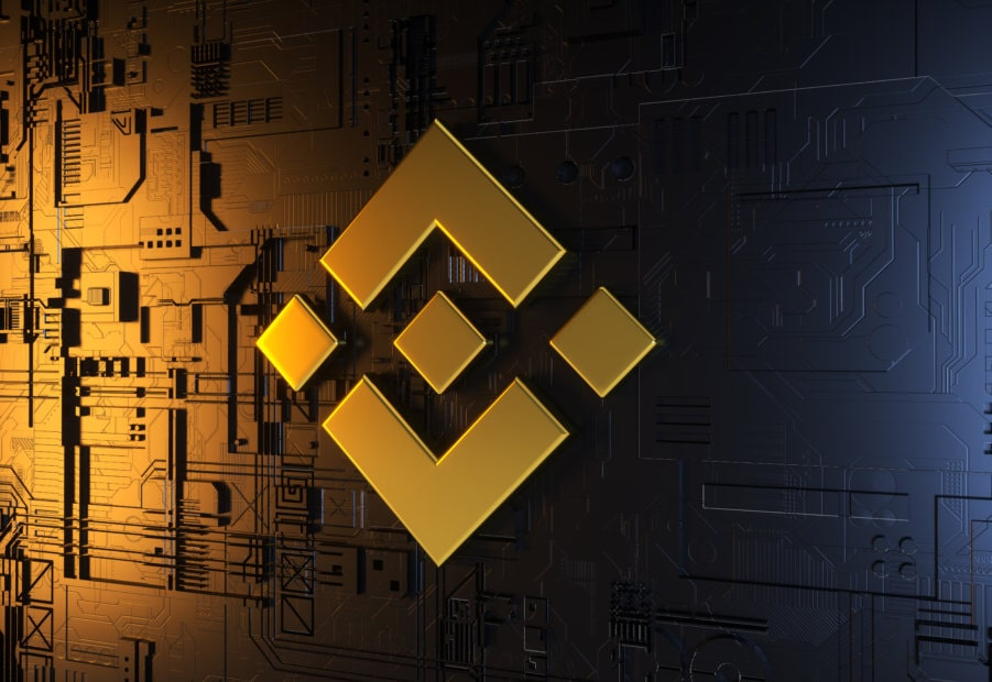 Binance Logo in gelb auf Computerchip