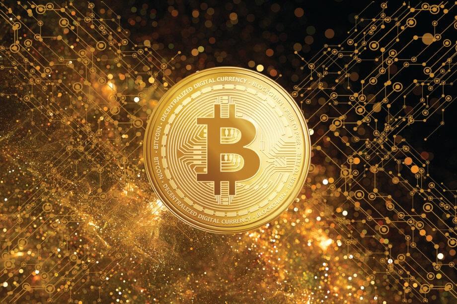 bitcoin-münze golden vor technologischem Hintergrund