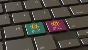 """Eine tastatur mit zwei bitcoin-symbolen: einmal """"buy"""" in grün und einmal """"sell"""" in rot"""