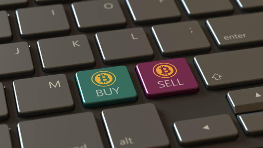 Eine tastatur mit zwei bitcoin-symbolen: einmal