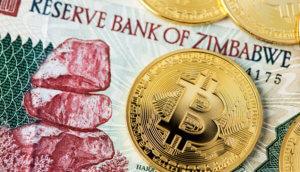 Bitcoin liegt auf Zimbabwe Banknote