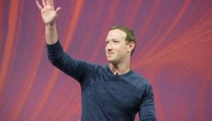 facebook chef markt zuckerberg winkt auf rotem hintergrund