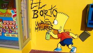 """bart simpson sprüht auf eine gelbe wand mit schwarzem lack sein tag """"el barto was here"""""""