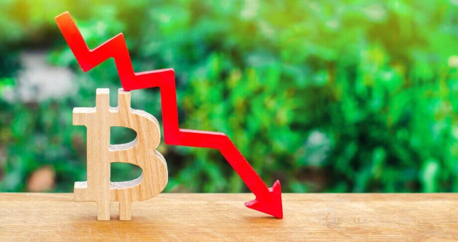 ein bitcoin-symbol mit einem roten chart
