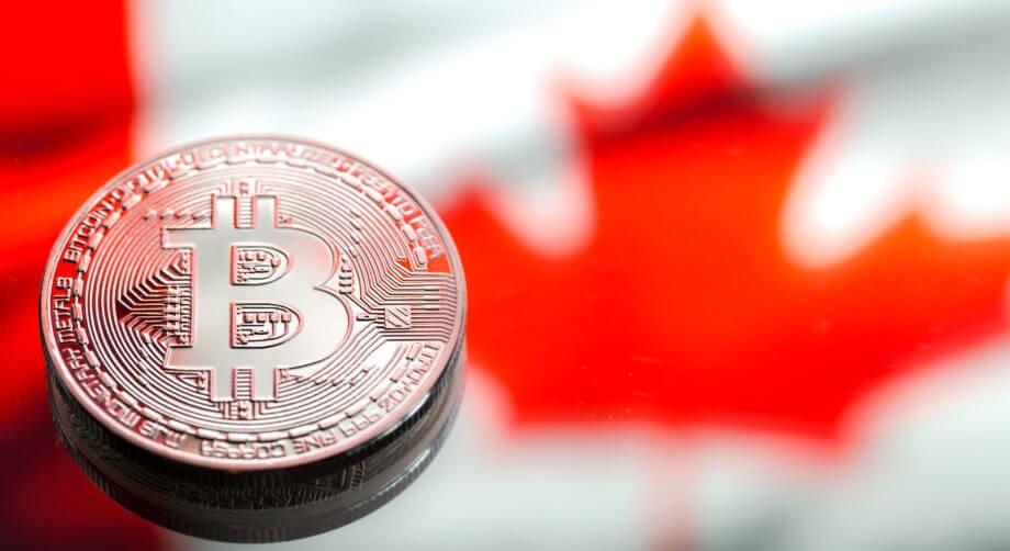 Bitcoin-Münze auf kanadischer Flagge