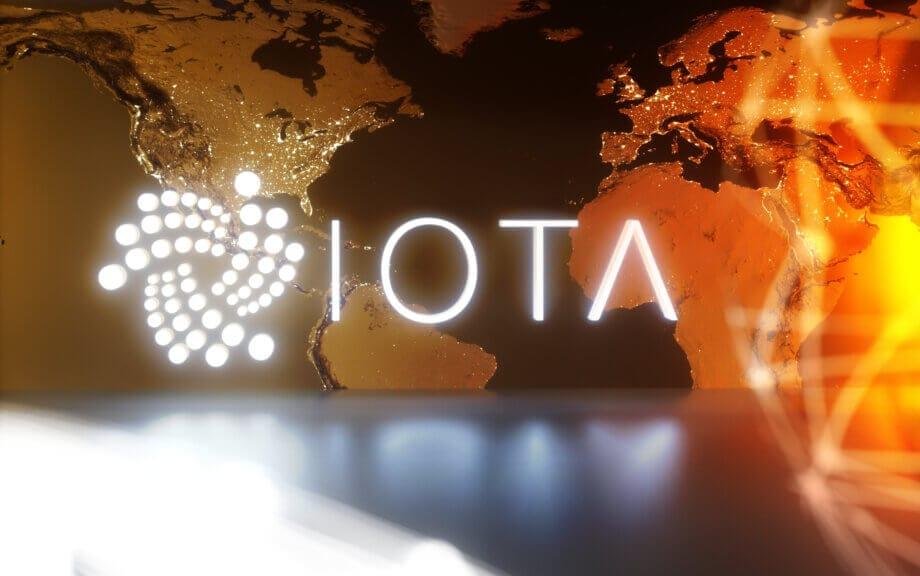 iota logo auf einem hintergrund, der ein stück der weltkarte zeigt
