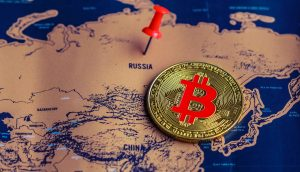 bitcoin-münze-auf-einer-weltkarte