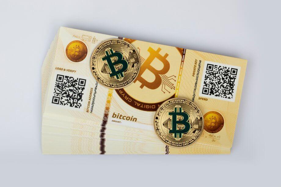 Bitcoin Paper Wallets und zwei physische Bitcoin-Münzen