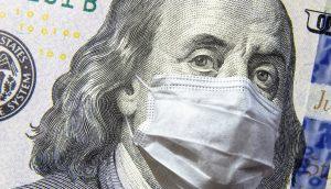 Dollar-Note mit Corona-Maske.