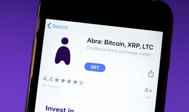 Abra Bitcoin app mobile logo close-up on screen display
