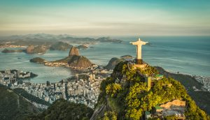 Aerial panorama of Christ and Sugar Loaf Mountain, Rio De Janeiro, Brazil.