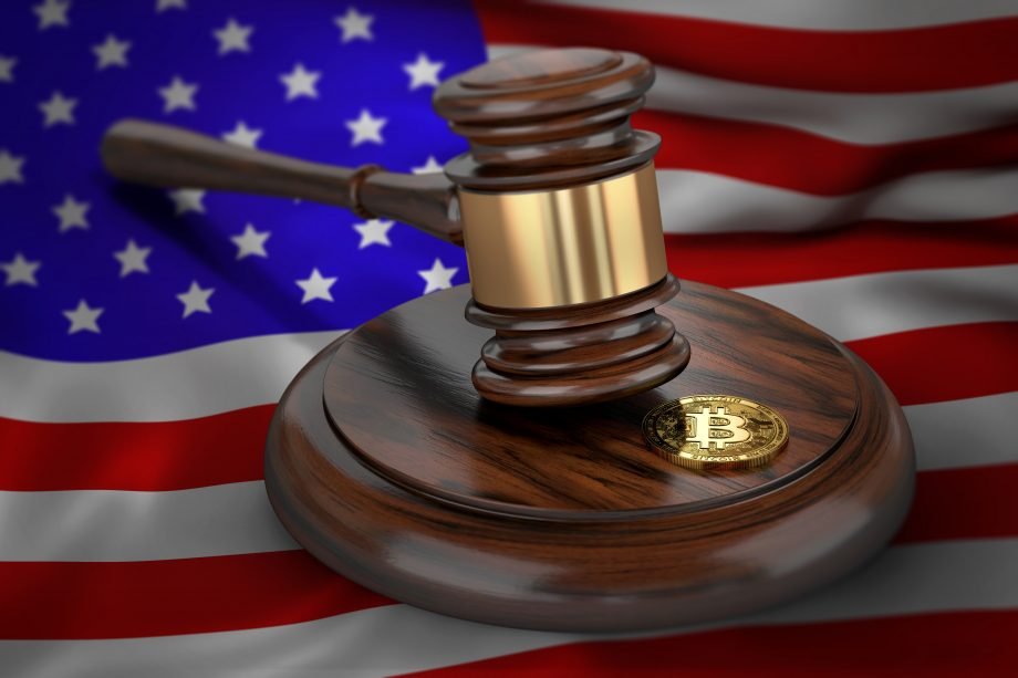 Bitcoin and judge gavel laying on flag of USA. Bitcoin legal situation in USA concept