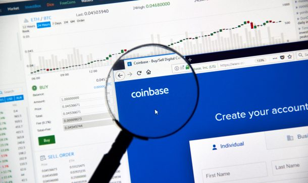 Coinbase cryptocurrency exchange website under magnifying glass