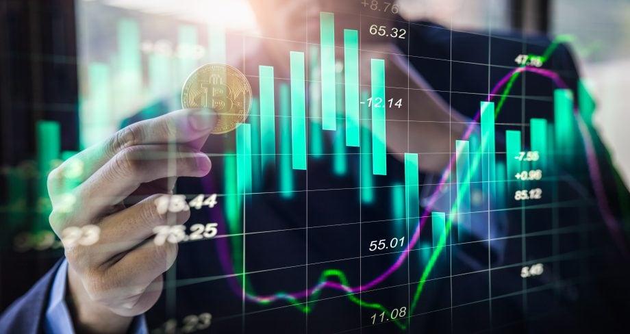 Bitcoin-Münze und Charts