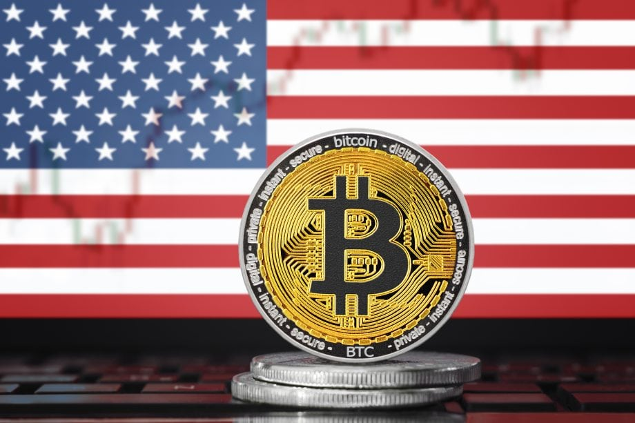 BITCOIN (BTC) cryptocurrency; coin bitcoin on the background of the flag of United States of America (USA)