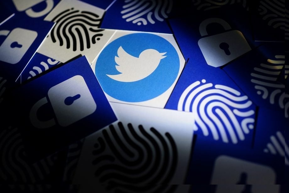 Twitter security and privacy issues. Hacker with computer hacking and stealing data information, Twitter logo and binary code as background.