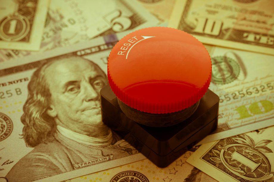 Reset-Knopf auf US-Dollar-Noten