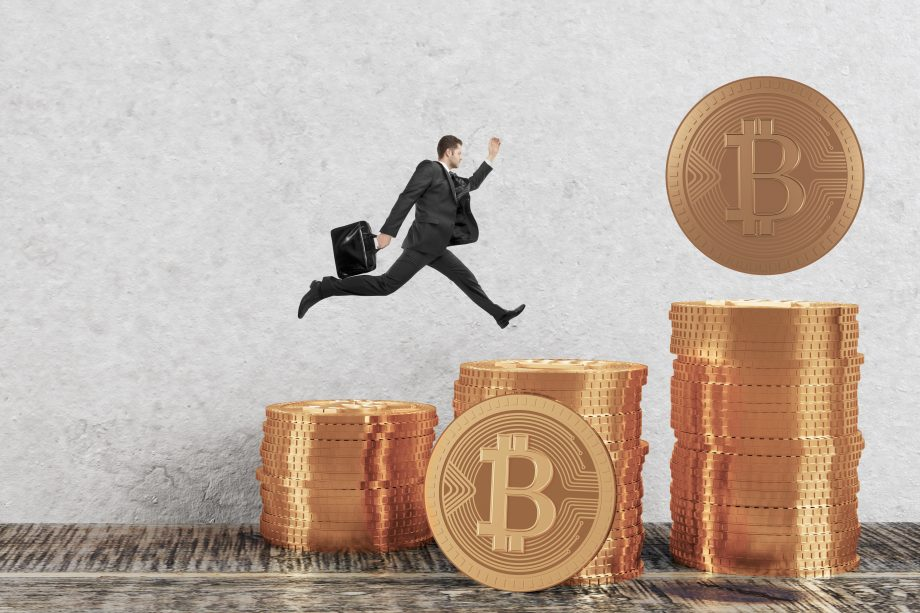 Businessman running on golden bitcoin piles in room. E-business concept. 3D Rendering