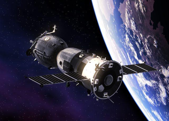 Bitcoin Satelit im Weltall umkreist die Welt.