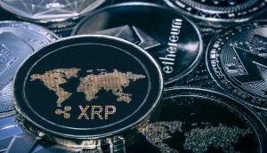 Münzen von Ethereum, XRP und IOTA