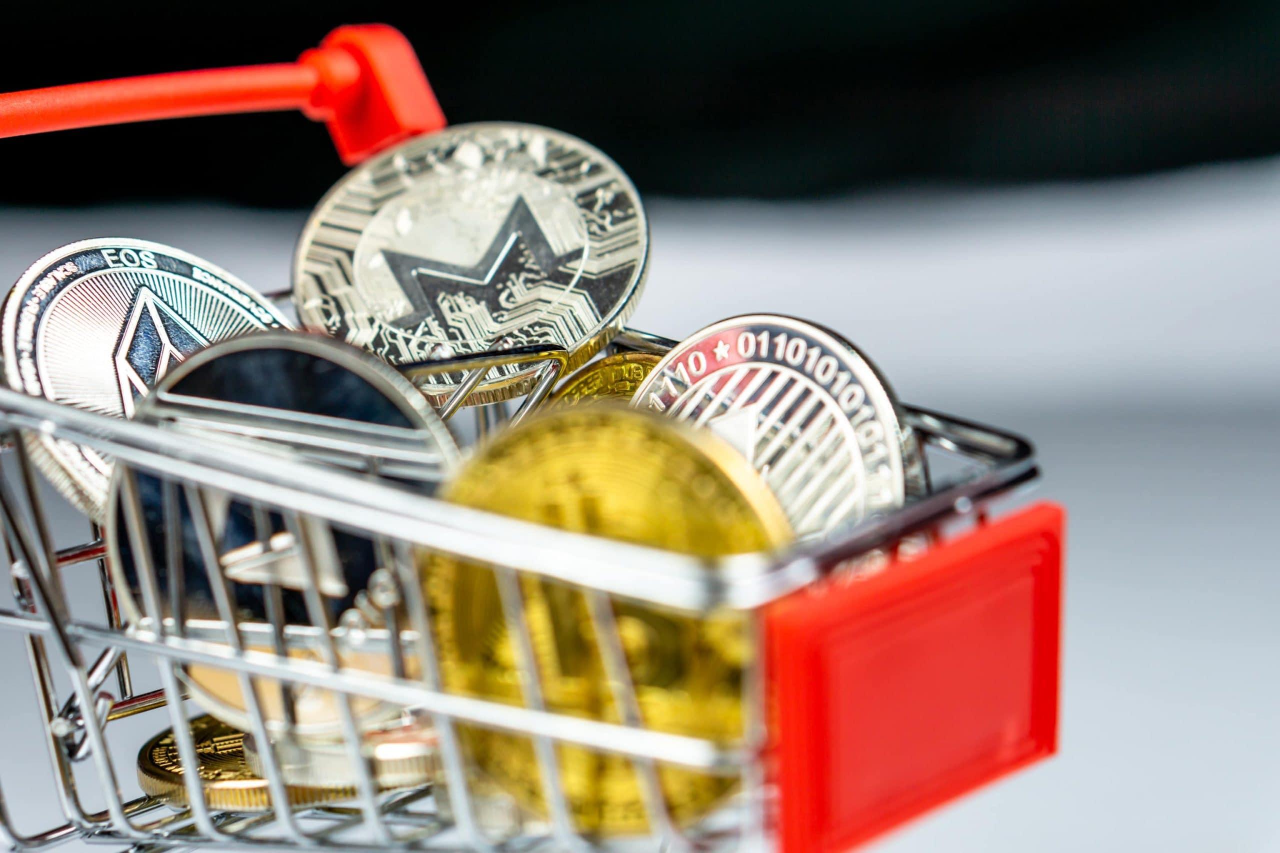 Bitcoin und Altcoins in einem Einkaufswagen