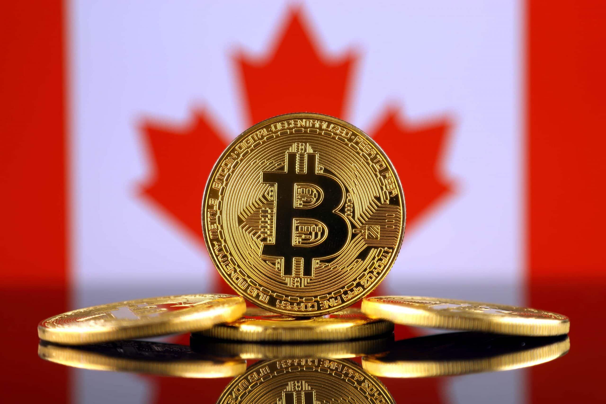 Bitcoin-Münze vor kanadischer Flagge