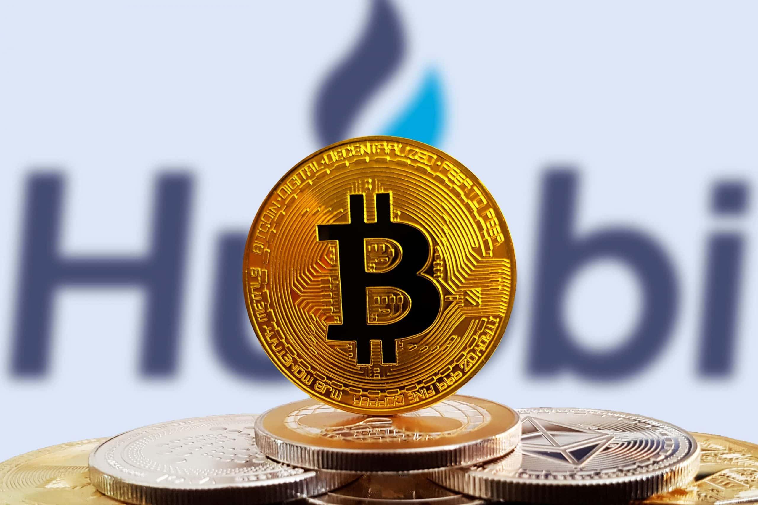 Huobi Logo mit Bitcoin-Münze