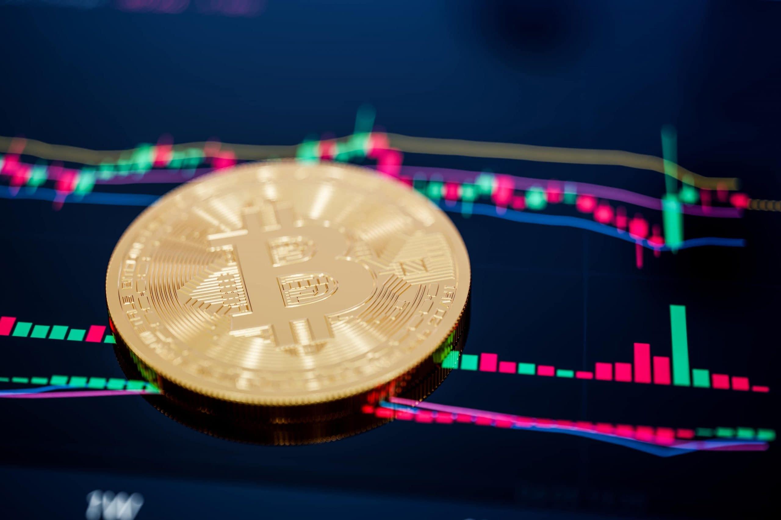 Bitcoin-Münze und Charttechnik symbolisieren Bitcoin-Wertpapiere