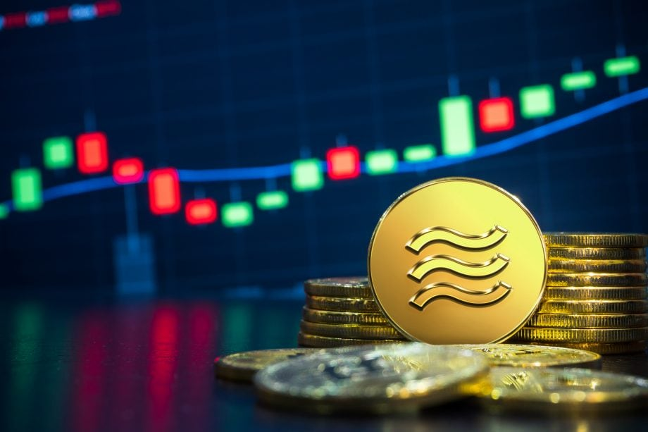 Libra-Münzen vor Chart-Hintergrund