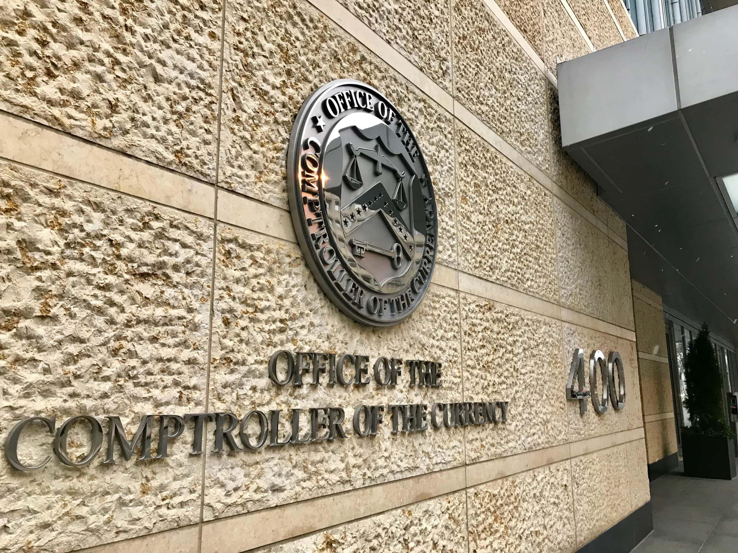 Das Logo der OCC an einer Gebäudewand.