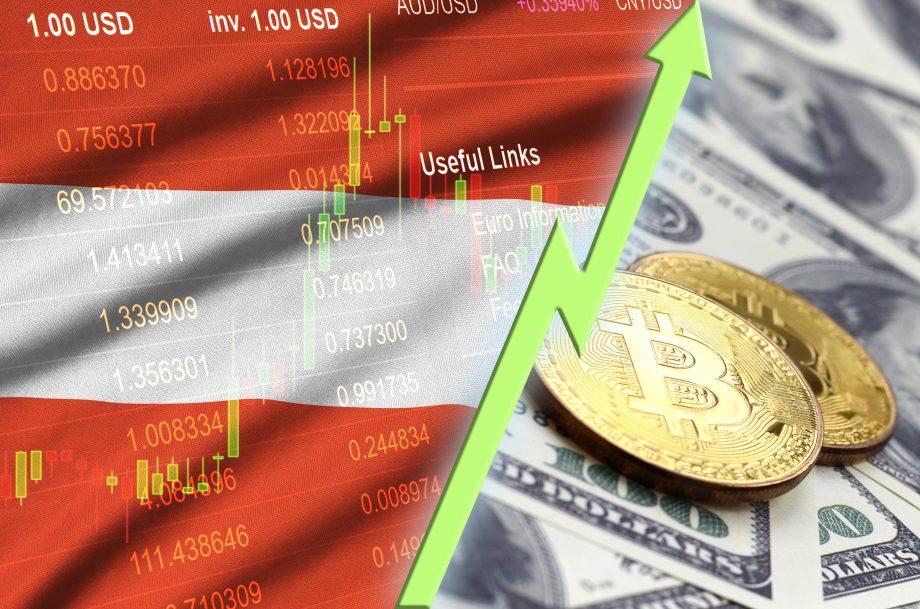 Österreichische Flagge auf einem Krypto-Kurs. Daneben liegen zwei Bitcoin auf einem Haufen US-Dollar