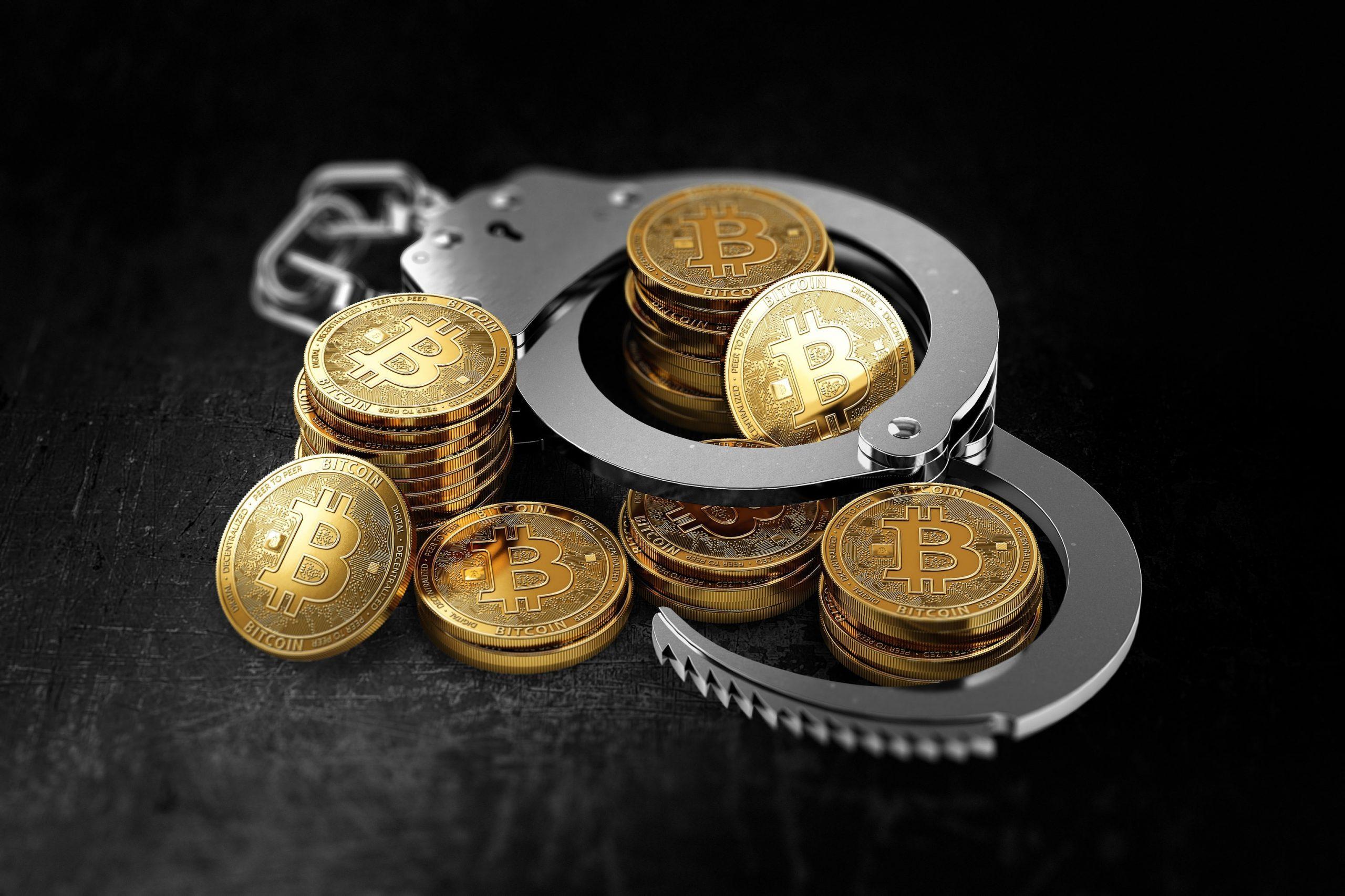 Bitcoin-Mnzen und Handschellen