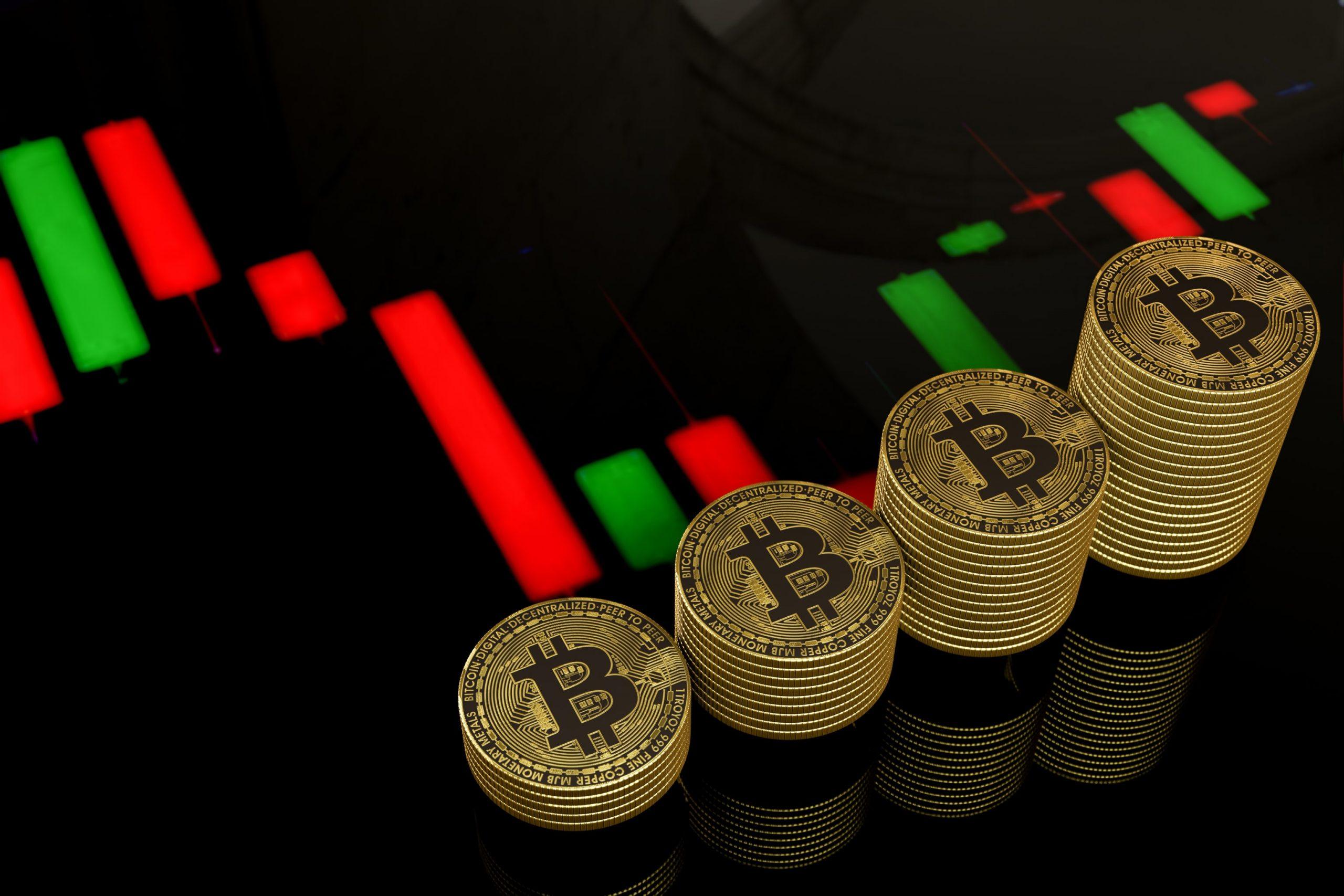 Bitcoin-Münzen auf einem Chart liegend