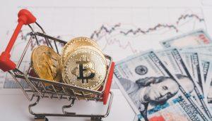 Bitcoin-Münzen in einem Einkaufswagen