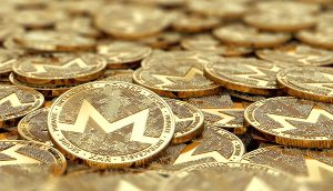 Stack,Of,Golden,Monero,Coins,In,Blurry,Closeup,With,Copy