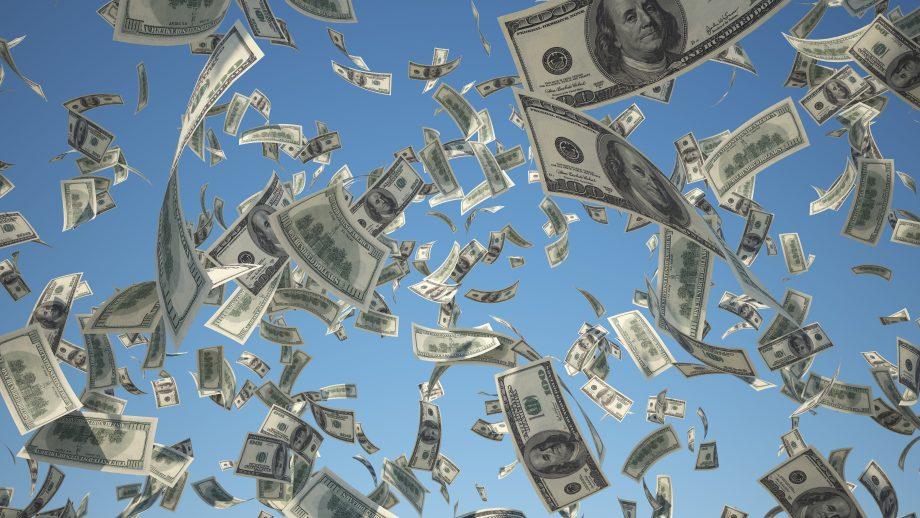 US-Dollar-Noten regnen vom Himmel.