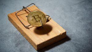 Bitcoin-Münze als Köder einer Mausefalle