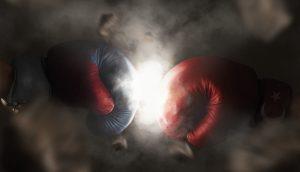 Zwei Boxhandschuhe prallen aufeinander.