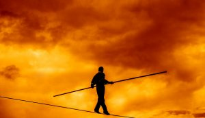 Wandering,Tightrope,Walker,Playing,On,Yellow,Sky,Background.,Silhouette,Of