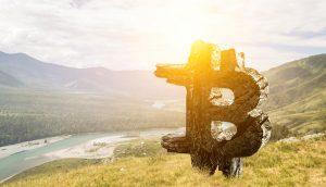 Bitcoin-Logo in Landschaft