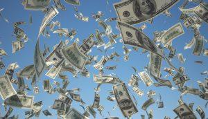 Ein Geldregen von US-Dollar-Noten.